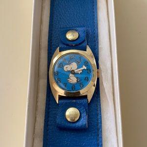 Very antique diamond tooled snoopy watch.